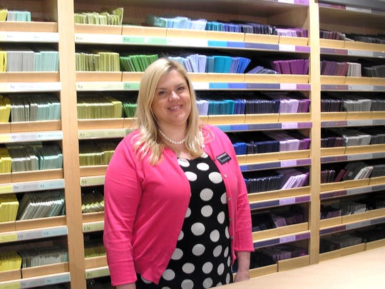 Suzanna Schroeder teaches the craft of card-making at the Paper Source in Glendale, where a wide array of papers and envelopes is available.