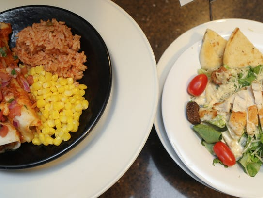A Mexican plate and a Cesar Chicken salad two of the