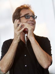 Huey Lewis and The News perform Saturday, July 18, 2015, during the RAGBRAI kick-off party outside the Tyson Events Center in Sioux City, Iowa.