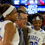 MTSU's head women's basketball Coach Rick Insell (center) and his players will hold the team's first open practice on Sunday.