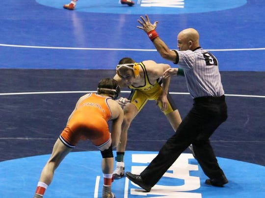 The second-round matches get under way during the NCAA Division I Wrestling Championships on Thursday, March 19, 2015, in St. Louis. (AP Photo/St. Louis Post-Dispatch, Chris Lee) MANDADORY CREDIT; EDWARDSVILLE INTELLIGENCER OUT; THE ALTON TELEGRAPH OUT