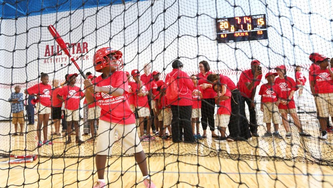 Jihair Crowder, tries out the brand new batting cage after the ribbon cutting for the Larry & Rhonda Sheakley Boys & Girls Club in Price Hill in this 2015 file photo. The new facility is 17,000 square feet. The project was one of Major League Baseball's Legacy Projects for the 2015 MLB All-Star Game.