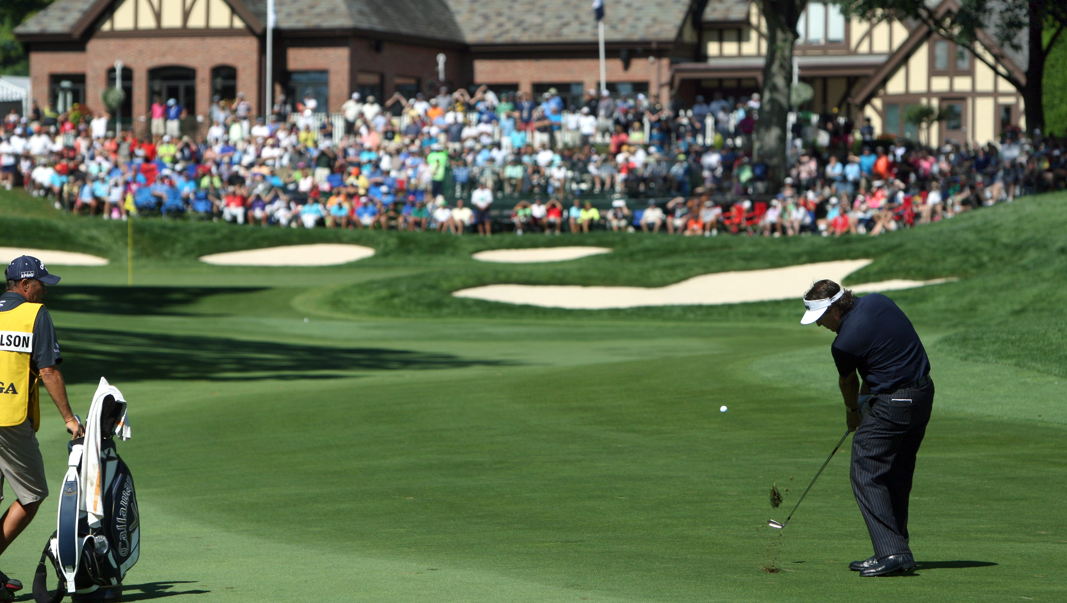 Phil Mickelson swings towards the green on 13 during the final round of the 95th PGA Championship.