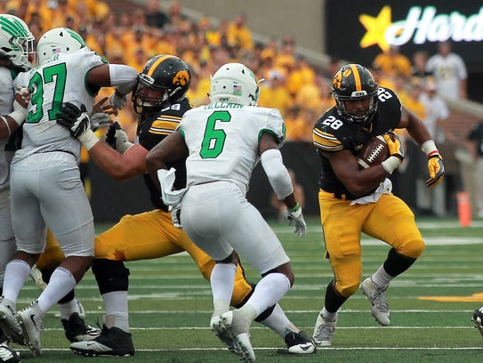Iowa running back Toren Young takes the ball down field