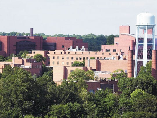DuPont opened its Experimental Station, one of the earliest industrial universities, in 1903.