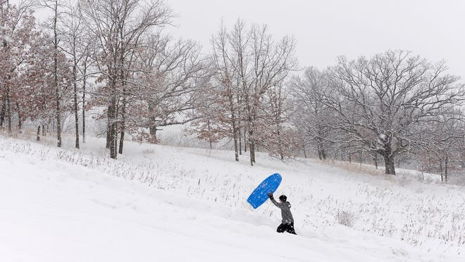 St. Cloud Christian School student  John Haas climbs up the sledding hill in February 2014 at St. John's Abbey Arboretum. The rolling terrain is the site of a ski race slated for Jan. 17.