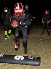 Ten year old Julyan Gutierrez runs over the step-over