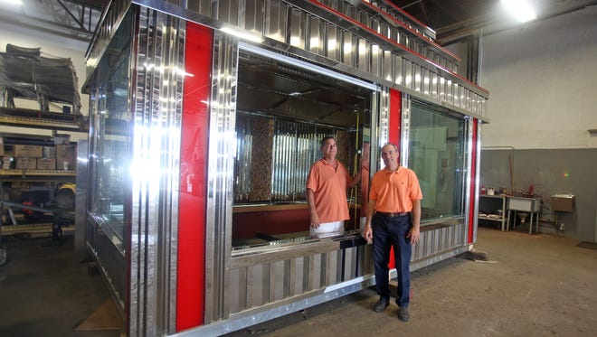 Phil and Joseph DeRaffele, along with a third brother Steve, are the owners of DeRaffele Manufacturing, a New Rochelle company that builds diners. They were photographed July 23 by a modular component of a diner being constructed at Main Street and Weyman Avenue in New Rochelle.