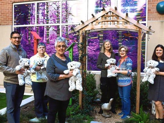 Xi Alpha Nu members donated stuffed bears for children