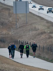 Law enforcement officers train on the Old Plank Road Trail Friday April 10, near Sheboygan Falls.