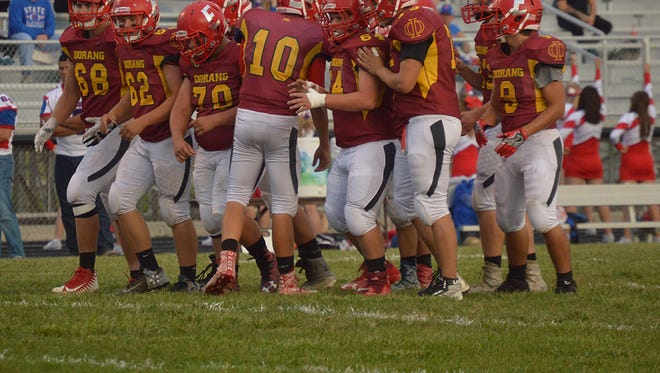 Elgin, wearing its throwback jerseys to the Oorang Indians, breaks the huddle in a game against Riverside earlier this year. The Comets already posted their first winning season since 2005.