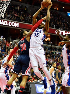 Feb 25, 2018; Washington, DC, USA; Philadelphia 76ers forward Trevor Booker (35) grabs a rebound and is fouled by Washington Wizards forward Mike Scott (30) during the first half at Capital One Arena. Mandatory Credit: Brad Mills-USA TODAY Sports