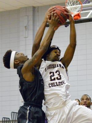 ANI LC vs UT Tyler Louisiana College's Steve Evans (23, right) comes up with a rebound against UT Tyler's Ceddrick Ali (10, left) Thursday, Jan. 15, 2015.-Melinda Martinez/mmartinez@thetowntalk.com