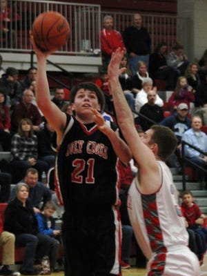 Tyler Bezold led Holy Cross with 20 points in a 65-52 win over Ludlow Monday in a Ninth Region All 'A' Classic game.