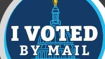 """The winning design for the """"I Voted"""" sticker contest, held by the R.I. Board of Elections, was designed by Wheeler School student Isaiah Suchman. It features the State House dome in shades of blue with a gold Independent Man on top."""