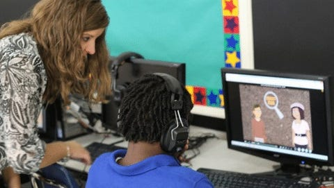 Lindsay Reams, a STAR Center learning specialist, works with a student.