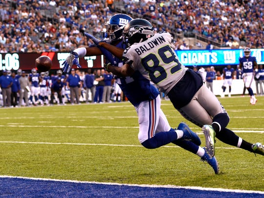 New York Giants cornerback Eli Apple (24) breaks up a pass intended for Seattle Seahawks wide receiver Doug Baldwin (89) in the first half. The Seattle Seahawks defeat the New York Giants 24-7 on Sunday, October 22, 2017 in East Rutherford, NJ.