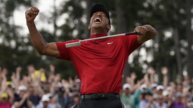 Tiger Woods reacts after he won last year's Masters in Augusta, Ga.
