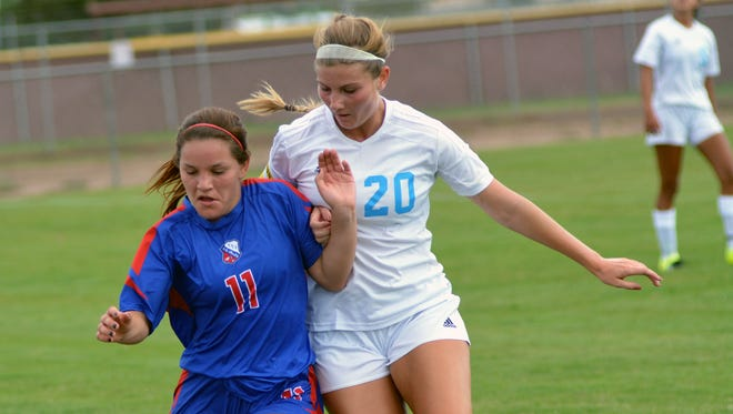 Las Cruces High's Taya Lopez (11) goes for the ball against Cleveland's Ashton Forrest (20) Saturday morning at the High Noon Soccer Complex.
