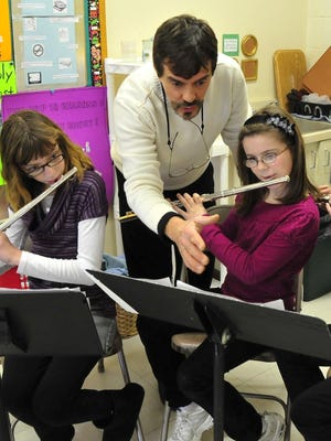 Dave Tripiciano instructs students at the Christian Academy of Western New York. Now director of instrumental music at Webster Christian School, Tripiciano has invited home-schoolers to join his music program there.