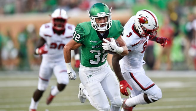 North Texas' Michael Lawrence (32) runs for a touchdown against Lamar defenders, including Jaylon Bowden, right, on Saturday, Sept. 2, 2017, in Denton.