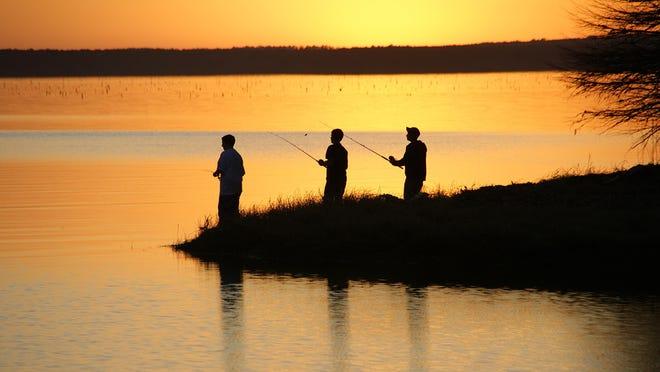 Some buddies fish at sunset on Toledo Bend Reservoir.