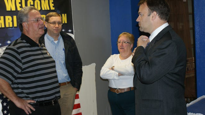 David Pepper (D) (right) is the Attorney General's Democratic candidate this November. Here, he is speaking (L-R) Bob Hille, Ottawa County Treasurer, Larry Hartlaub, Ottawa County Auditor and Jodi Regal, Ottawa County Commissioner.