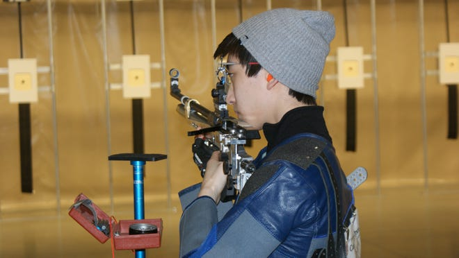 Brendan Whitaker prepares to line his rifle on target during the Super Final at Saturday's Camp Perry Open.