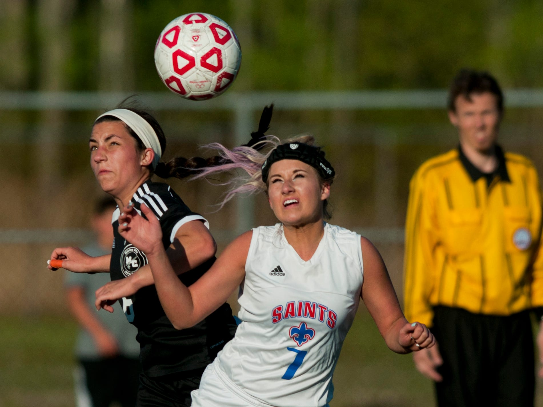 Marine City senior Olivia Viney and St. Clair senior Laura Bluhm attempt to head the ball during a soccer same Wednesday, May 13, 2015 at East China Stadium.