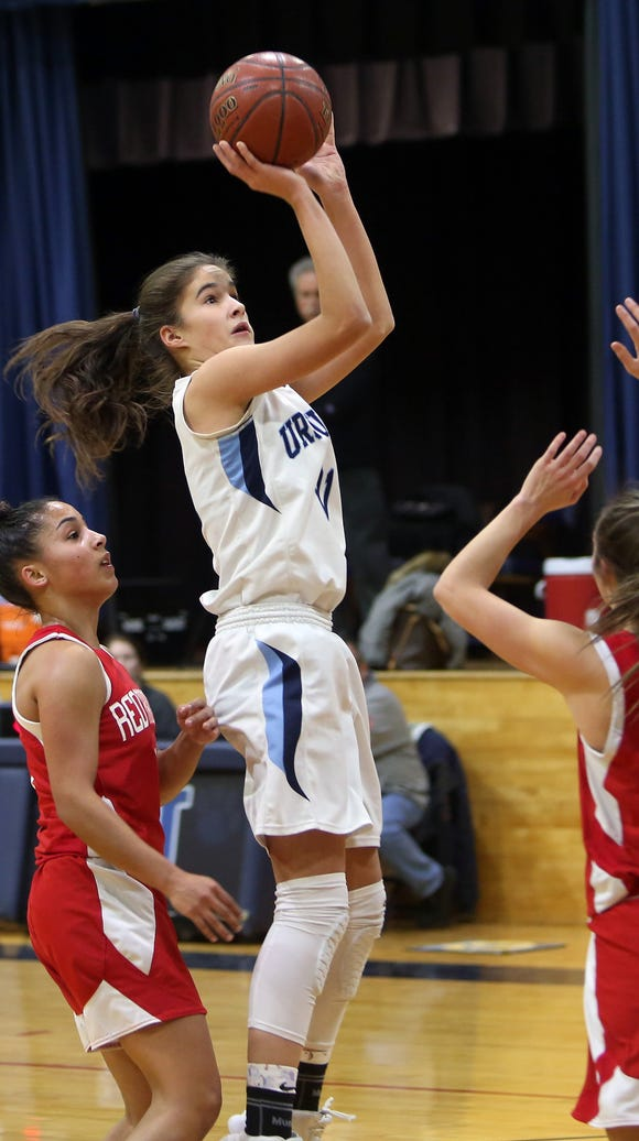 Ursuline's Sonia Citron (21) puts up a shot in front