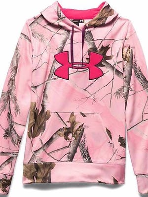 """Outdoors attire in """"hunter pink"""" is allowed but Michigan hunters must also wear blaze orange, a new ruling says."""