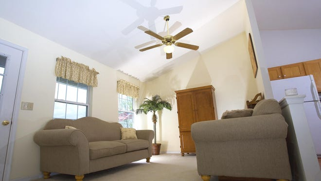A ceiling fan won't lower the temperature in a room significantly, but it will feel cooler.