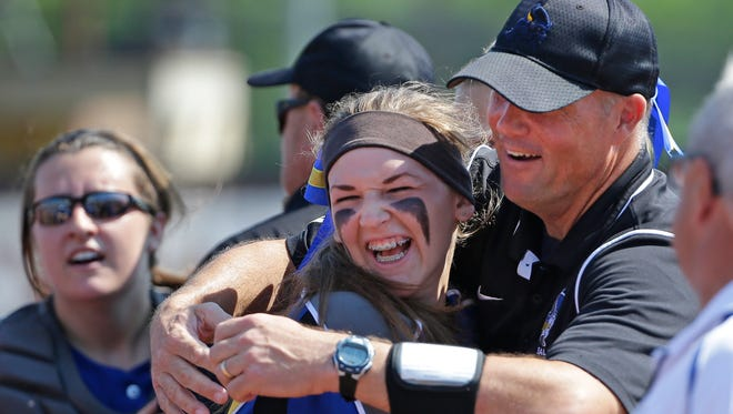 New Berlin West pitcher Cheyenne Sowinski celebrates a complete game victory with head coach Greg Klotz in Division 2 of the WIAA girls state softball tournament on June 10, 2016. Sowinski became New Berlin West's top pitcher last year.