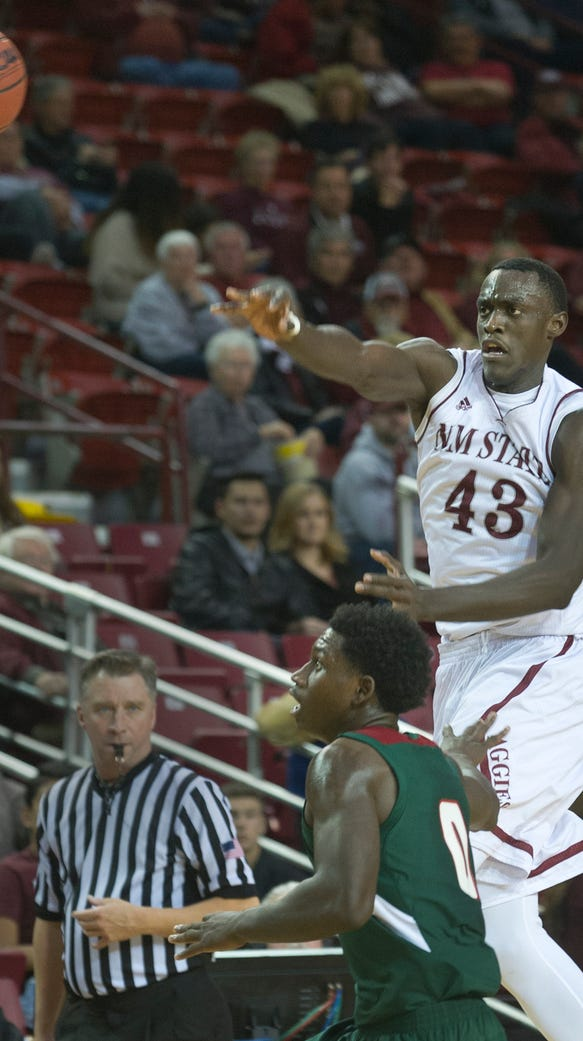 New Mexico State forward Pascal Siakam pushes the ball