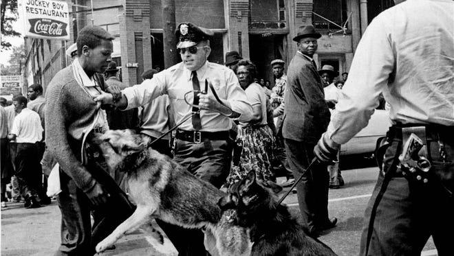Police dog attacks 17-year-old civil rights demonstrator in 1963 in Birmingham, Ala.