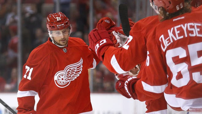 Detroit Red Wings left wing Tomas Tatar celebrates his goal against the Boston Bruins on Oct. 15, 2014.