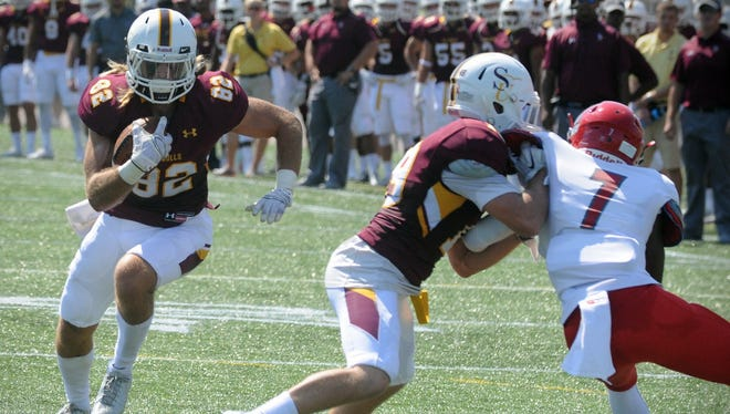 Salisbury wide receiver Brad Rose runs around a block after catching a pass against Montclair State on Saturday, Sept. 17 at Sea Gull Stadium in Salisbury.