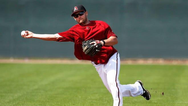 Arizona Diamondbacks Chris Owings fields a ground ball and throws to first base during spring training on Thursday, Feb. 26, 2015 at Salt River Fields near Scottsdale.