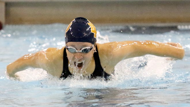 Molly Craig of Elmira Notre Dame swims to a first place finish in the 100 butterfly during the Dr. Jack Thomas Girls Swimming and Diving  during the Invitational at Ernie Davis Academy's Thomas Natatorium on Saturday.