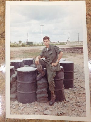 "A photo of a soldier was left at the Dollar Tree store in Park Ridge, N.J., late last month. The manager, Ken Norris, hopes someone will recognize the soldier, and claim the photo. On the back is written: ""Viet Nam June 1969: My husband in his favorite spot where he sits and makes his tapes to send to me. It is a little bunker in front of BN Headquarters and looking straight out is the base camp perimeter about 300 yards."""