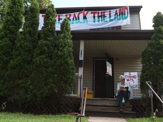 Several members of Take Back the Land including Lilita Lassen-Ward of Fairport keep watch at Liz McGriff's home on Cedarwood Terrace in case the police come to evict her.  McGriff, who had been previously evicted but was living in the home, received a recent eviction notice that the sheriff's department was going to physically remove her belongings Monday.