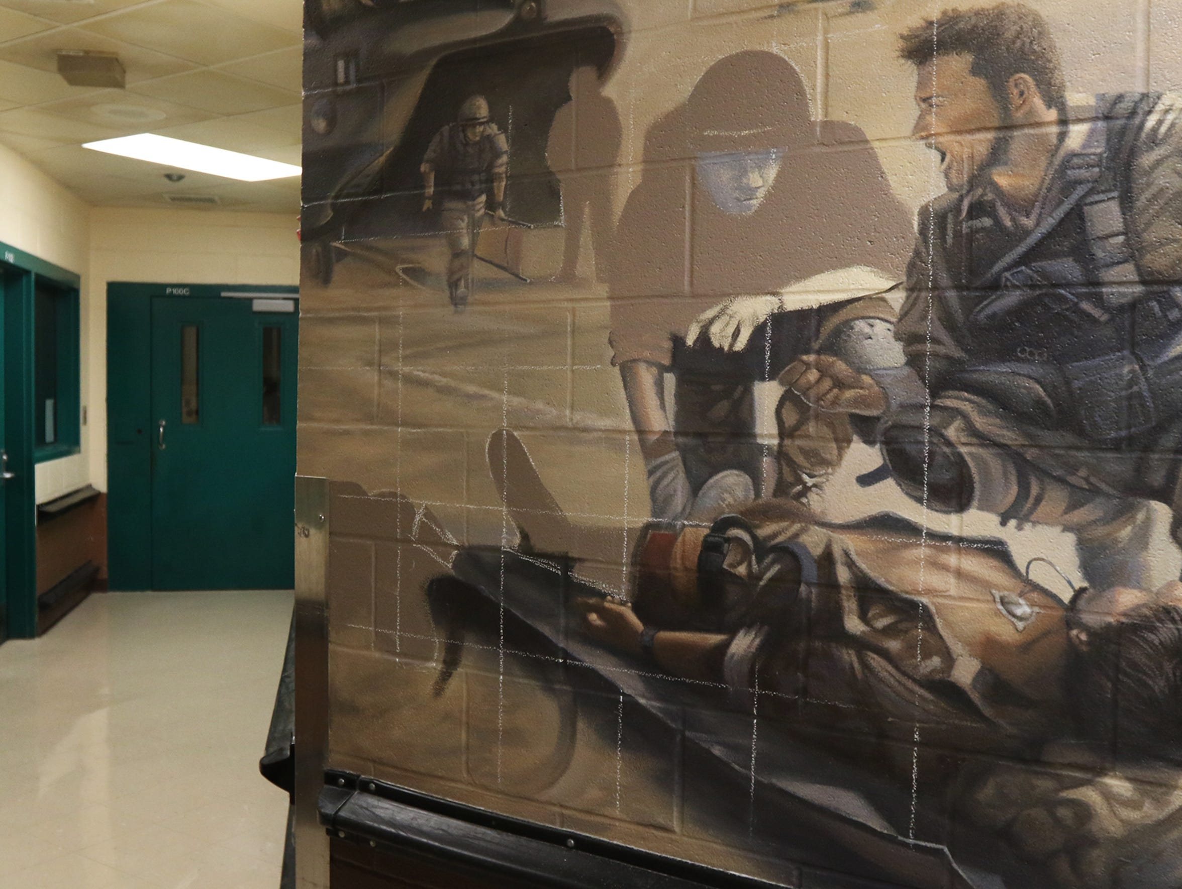 An inmate donated his time and talent to create this mural outside the veterans housing unit of the Monroe County Jail.