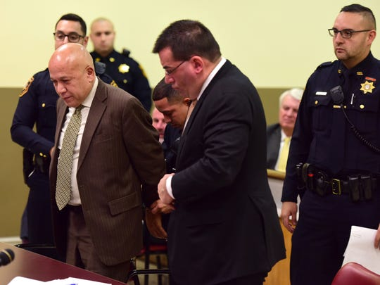 "Joseph ""Joey"" Torres is handcuffed after he was sentenced to five years of prison time for his role in a corruption scandal during his time a Paterson mayor before Hudson County Superior Court Judge Sheila Ann Venable Tuesday morning."