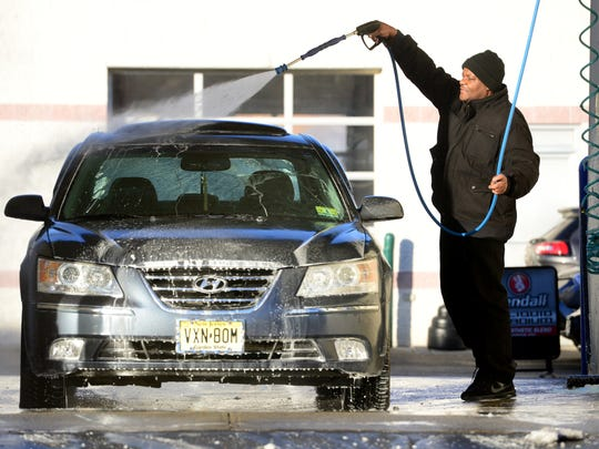 Joe Youngblood, of Hackensack, washes the salt from his car Tuesday morning on December 26, 2017.