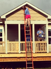 Members of the Young Leadership Division spent a morning volunteering at the Greater Indy Habitat for Humanity Indiana State Fair build on Aug. 16.
