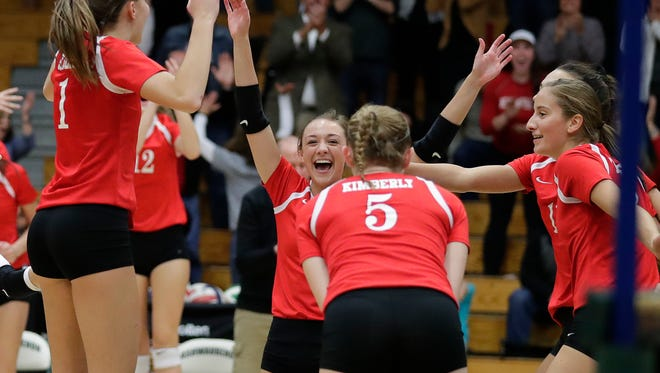 Kimberly celebrates match point against Bay Port on Oct. 26 in a WIAA Division 1 girls volleyball sectional semifinal at Ashwaubenon High School.