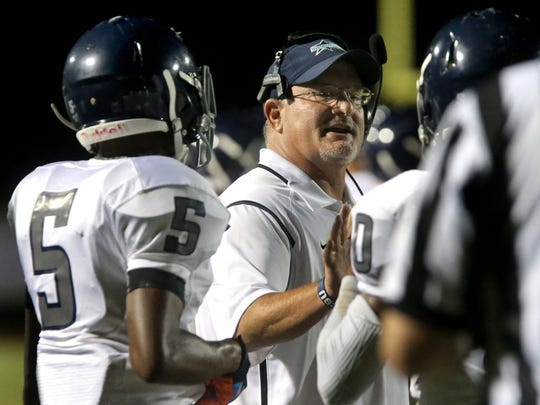Siegel's head football Coach Greg Wyant talks to his players during a break in the game against Summit in the third Jamboree game on Friday Aug. 14, 2015, at Stewarts Creek.