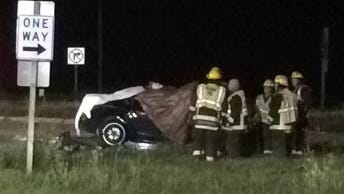 The car was mangled and covered in tarps after colliding Tuesday evening with a bus on Wisconsin 29.