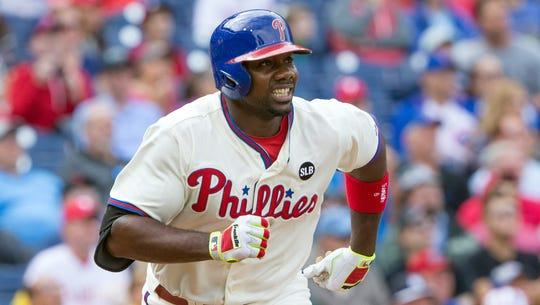 Phillies first baseman Ryan Howard runs the bases after