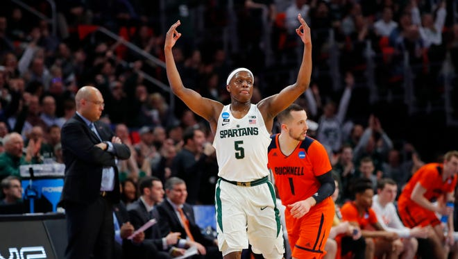 Michigan State Spartans guard Cassius Winston celebrates a three-pointer against Bucknell in the first round.